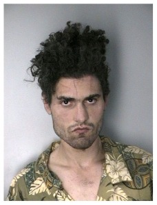 This guy was arrested for stealing Lyle Lovett's hair.